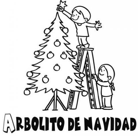 Niños decorando el árbol de Navidad. Imágenes gratis