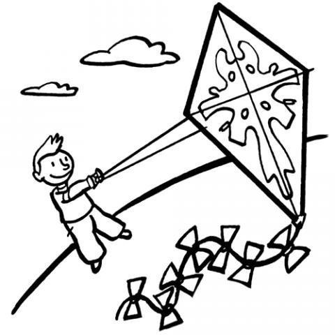 Niño jugando con una cometa